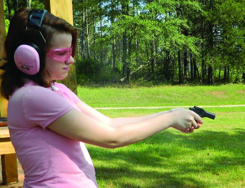 female shooter with High Standard 22 derringer