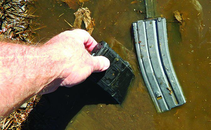 gun magazine in mud